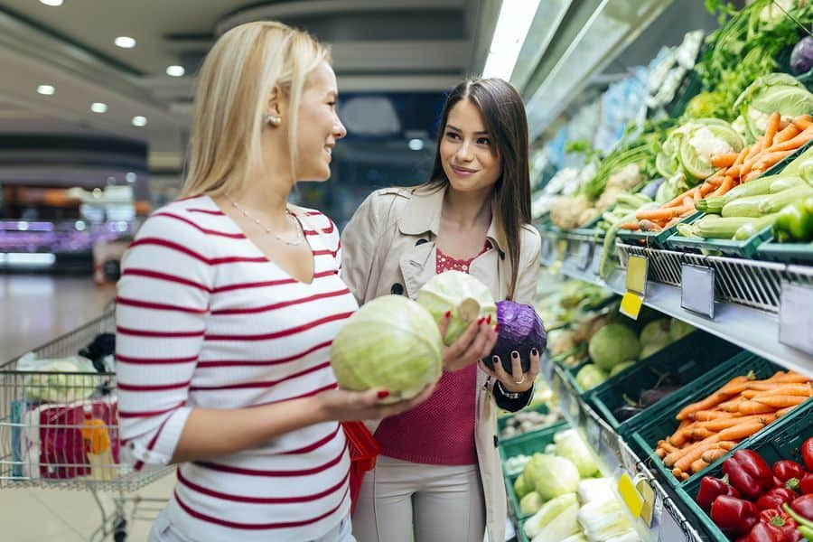 women shopping vegetables and fruits in the supermarket