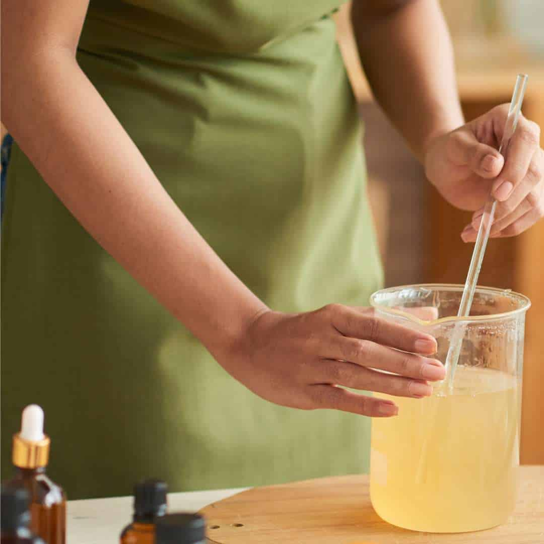 a woman making natural washing up liquid at home