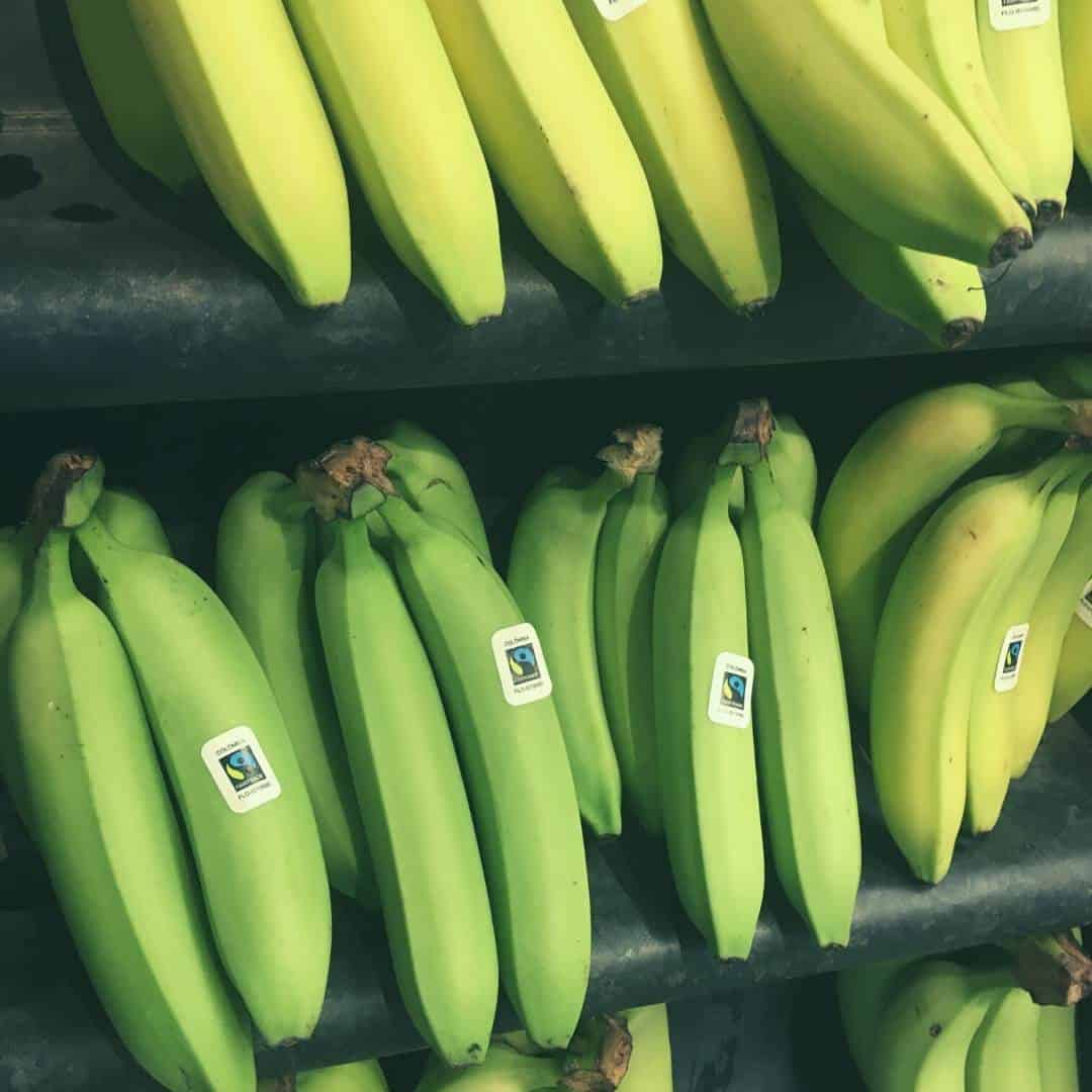 green bananas in the shop