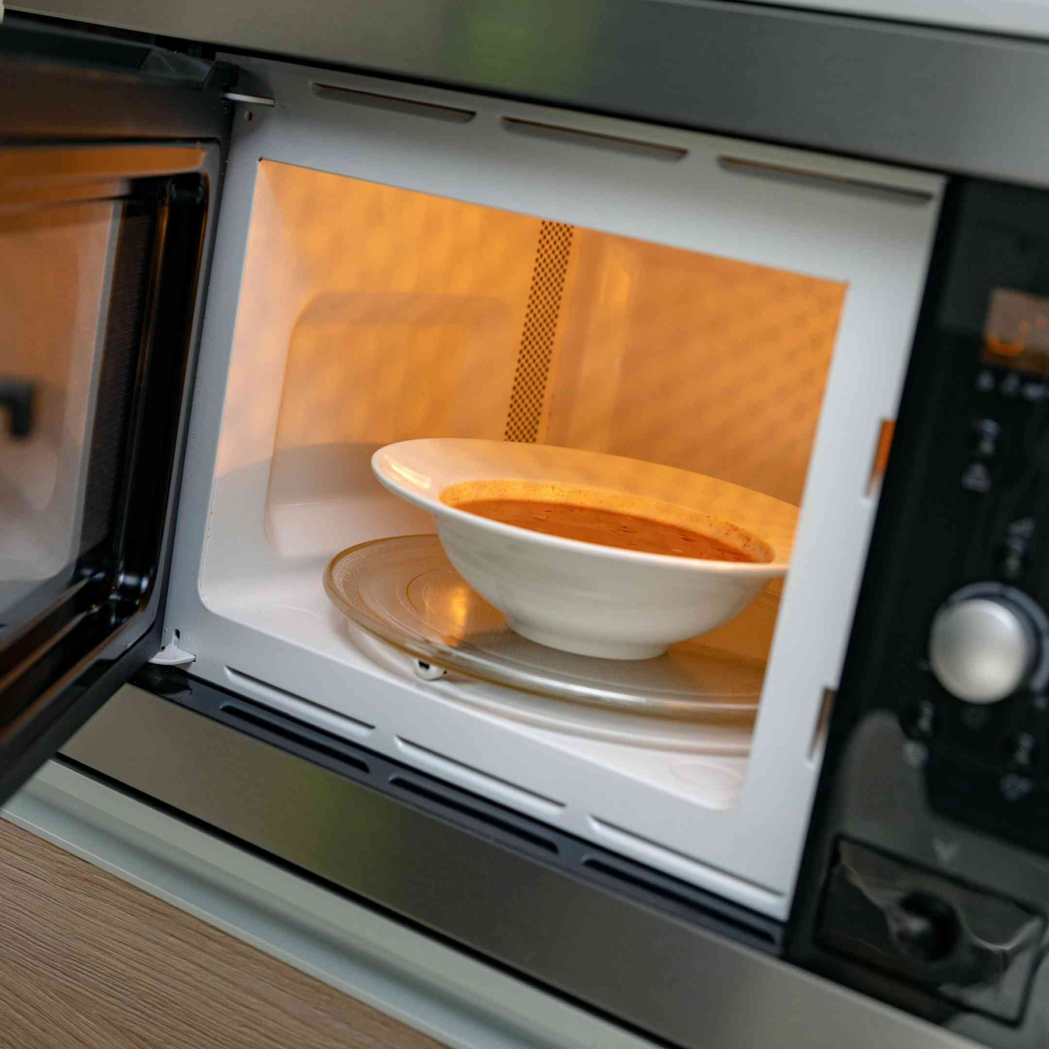a bowl of soup in the microwave