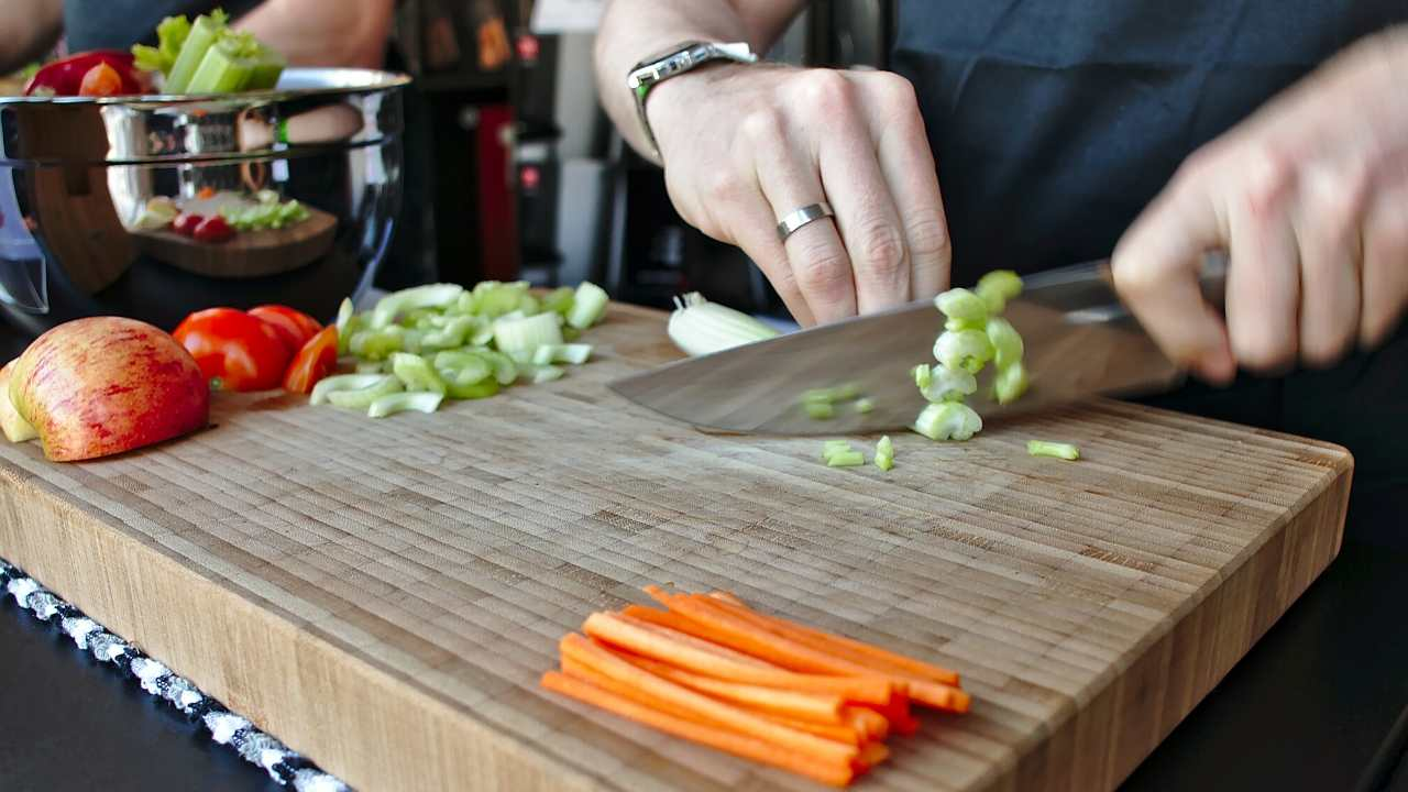 using knife to cut veggies