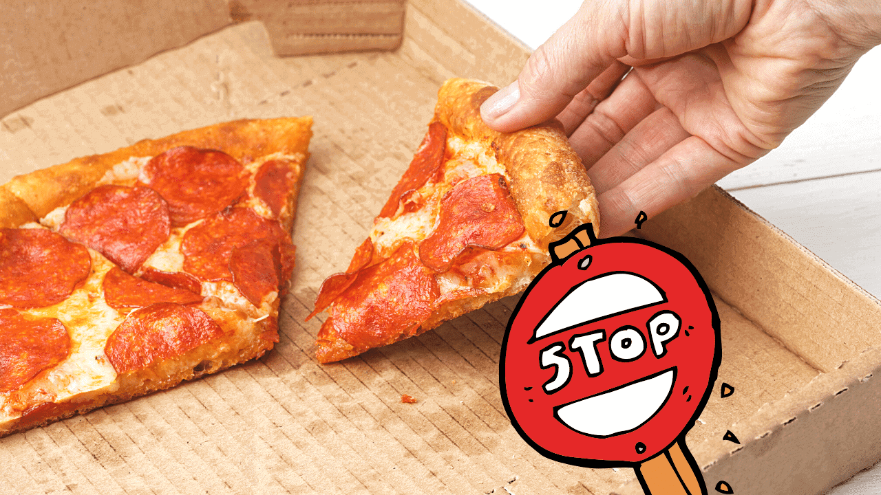 a person is taking a slice of leftover pizza