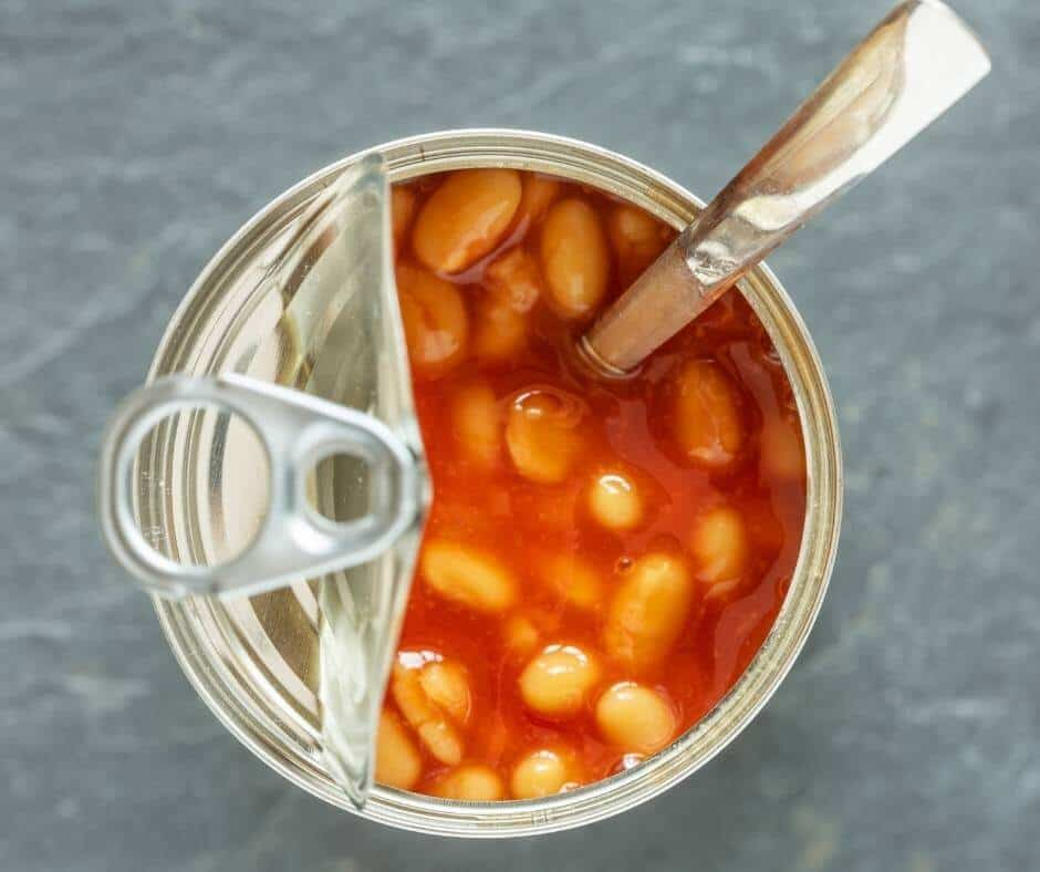eating baked beans from the can