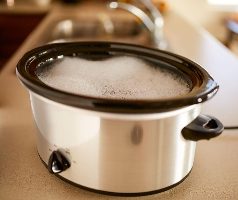 scrubbing washing crockpot