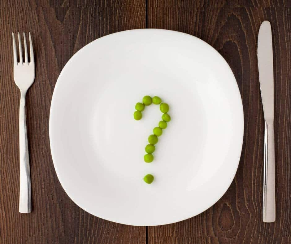 dinner plate with peas on it