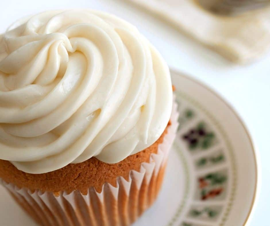 cupcake with cream cheese frosting on top