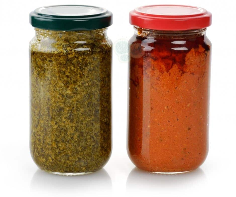 green and red pesto in jar