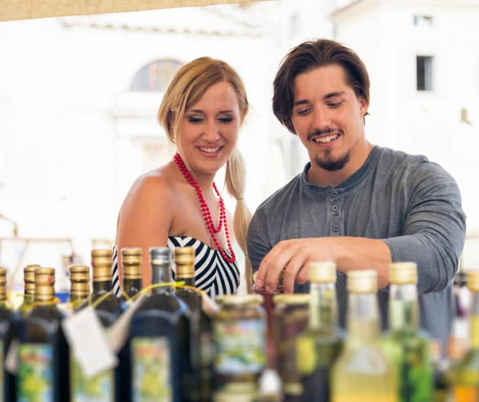 a couple is choosing the best quality olive oil
