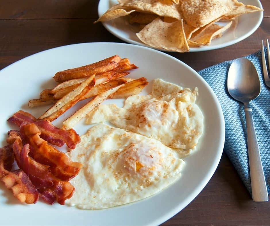 over easy eggs and bacon on a plate